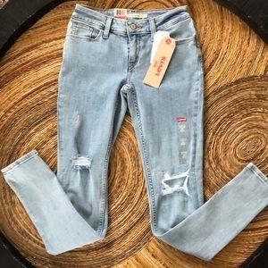 Levi's 535 Super Skinny distressed splatter jeans